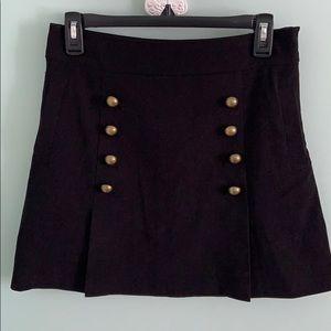 black skirt w gold dot things